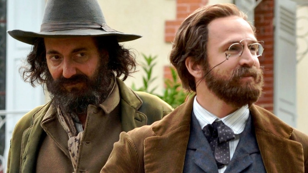 Paul Cézanne (Guillaume Gallienne) and Émile Zola (Guillaume Canet) standing next to each other.
