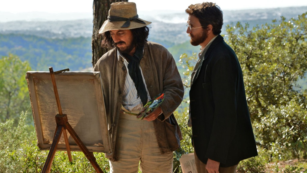 Émile Zola (Guillaume Canet) talking Paul Cézanne (Guillaume Gallienne) as the latter paints.