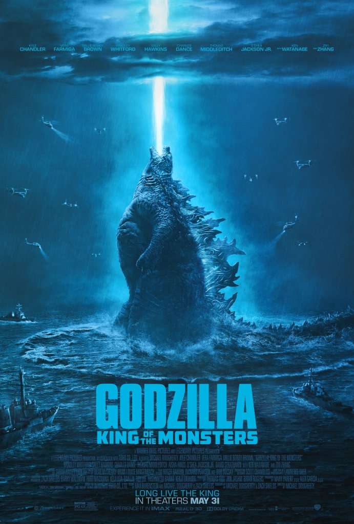 The film poster showing Godzilla, a shaft of light coming from its screaming mouth. Its surrounded by helicopters and ships.