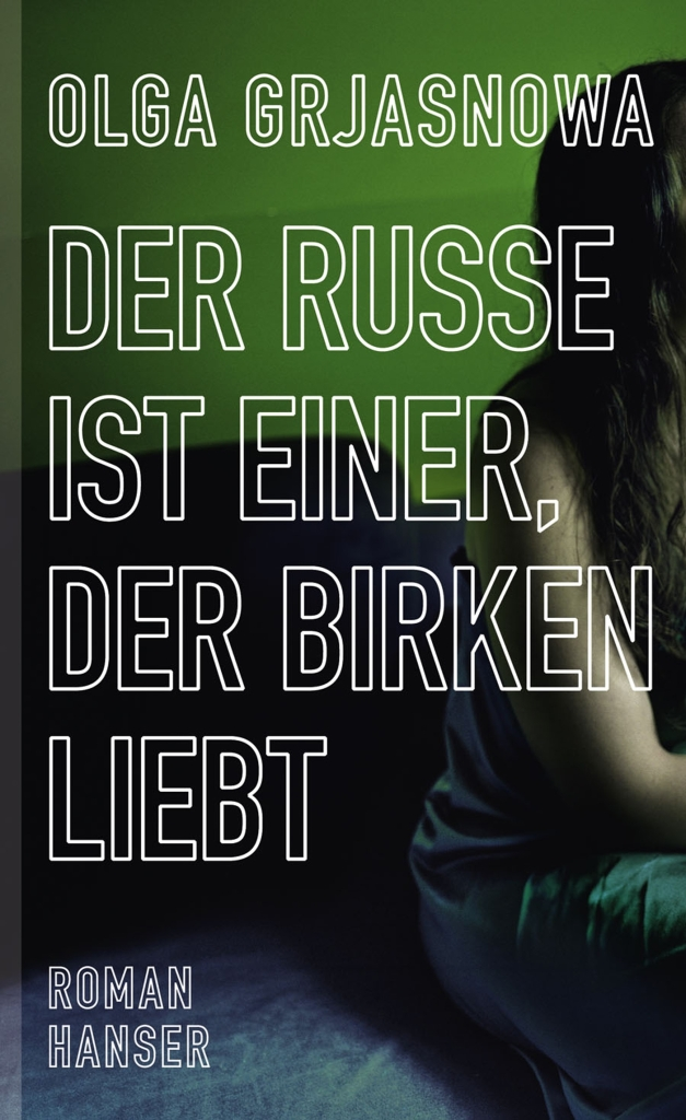The book cover showing half of a sitting woman, so you can't see her face, in front of a green background.