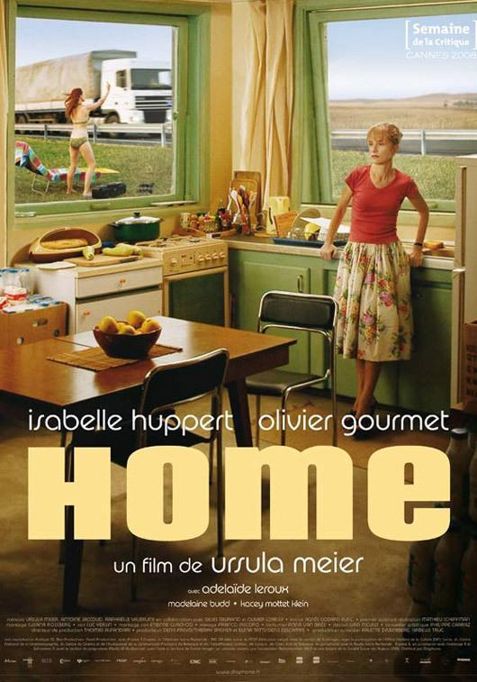 The film poster showing Marthe (Isabelle Huppert) standing in her kitchen with a truck rushing past just outside her window. Behind her on the lawn is her daughter Judith (Adélaïde Leroux) giving the truck the finger.