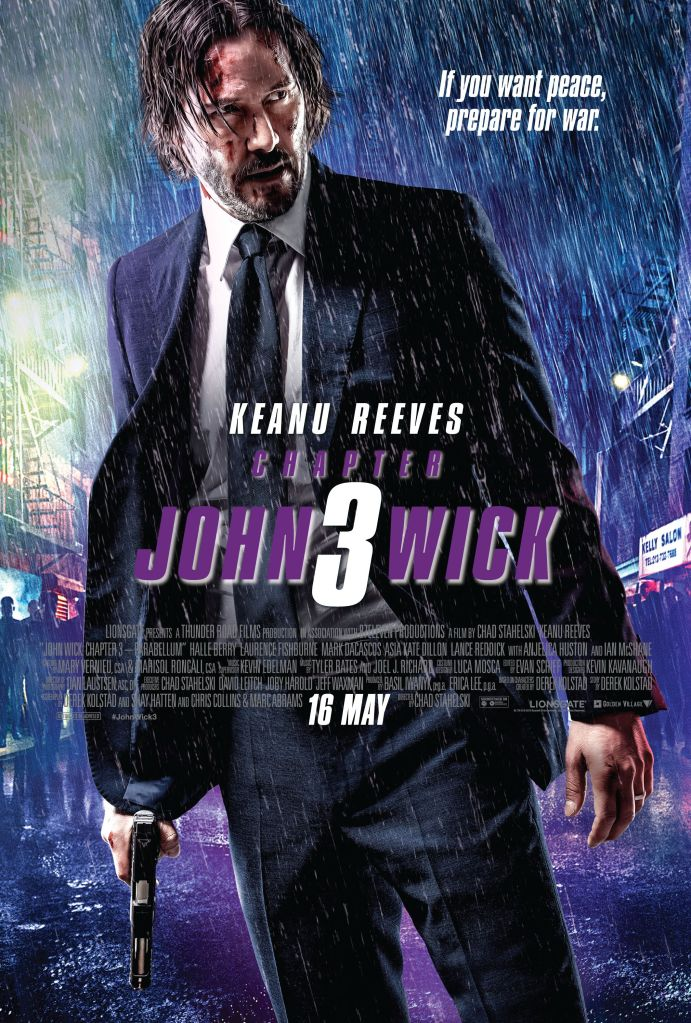 The film poster showing John Wick (Keanu Reeves) standing in the rain with a bruised face and a gun in his hand.