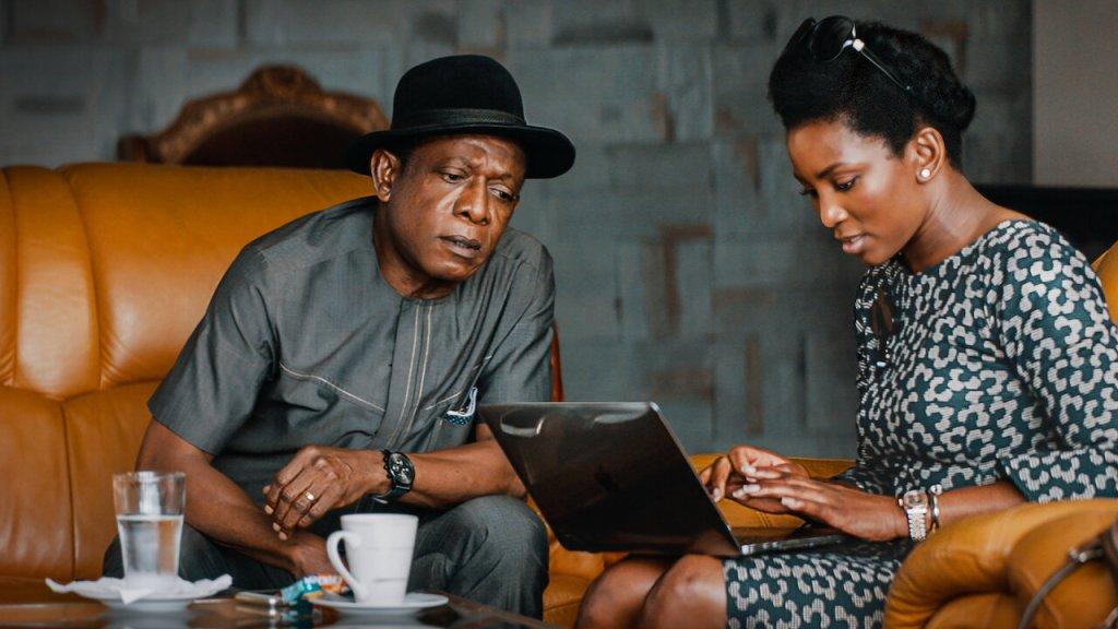 Adaeze (Genevieve Nnaji) with her uncle Godswill (Nkem Owoh).