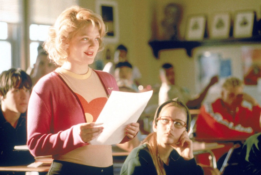 Josie (Drew Barrymore) reading something in class.