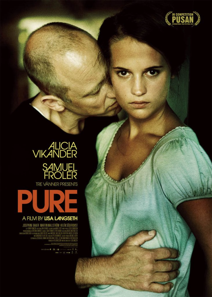 The film poster showing Katarina (Alicia Vikander) looking fiercely at the camera, while Adam (Samuel Fröler) holds her and smells her neck.