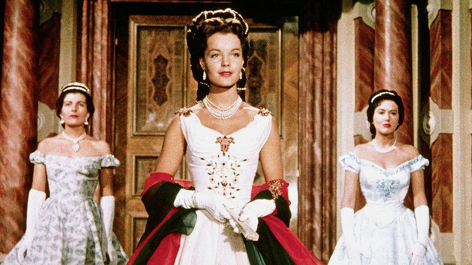 Sissi (Romy Schneider in a white dress.
