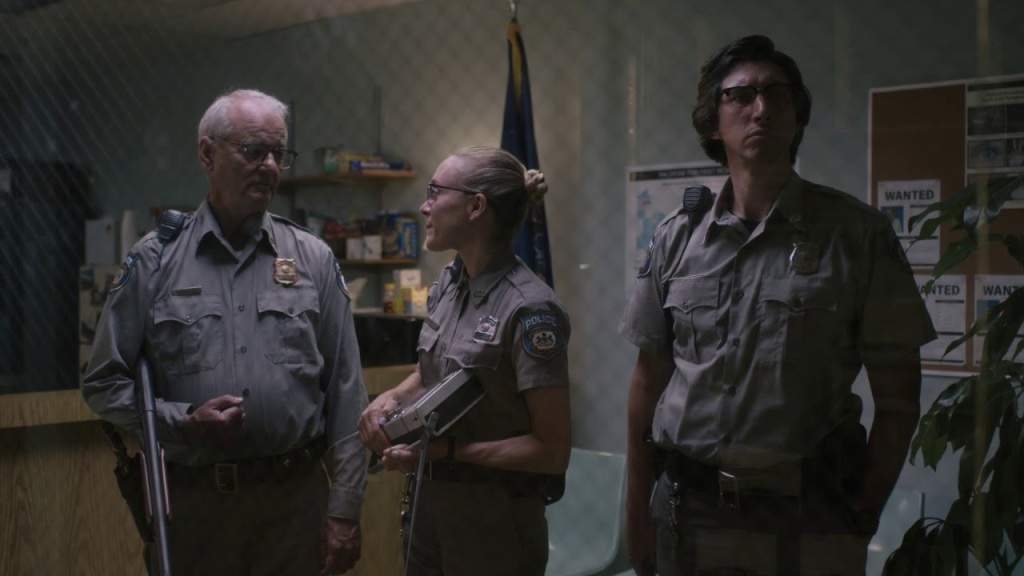 Police officers Mindy (Chloë Sevigny), Cliff (Bill Murray) and Ronnie (Adam Driver) in the police station.