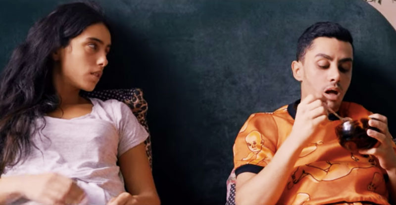 Lila (Hafsia Herzi) talking to her best friend Ali (Djanis Bouzyani) as they have breakfast in bed together.