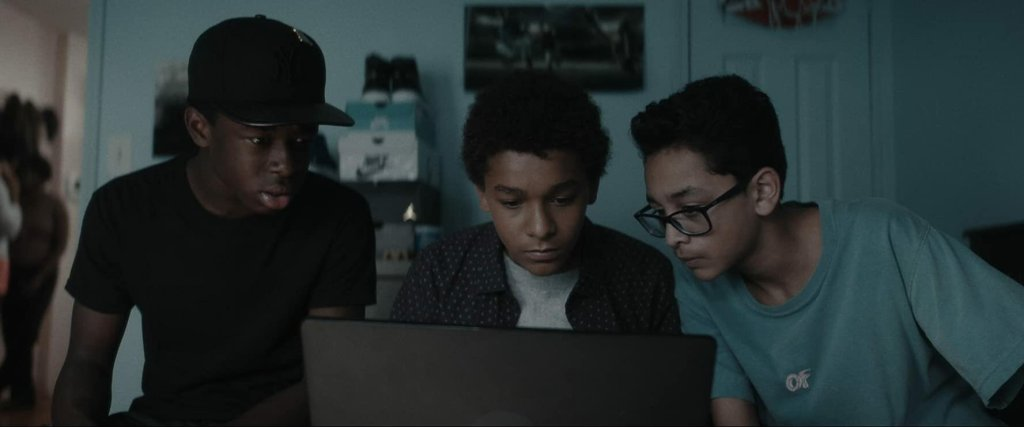 Miguel (Jaden Michael), Luis (Gregory Diaz IV) and Bobby (Gerald Jones III) looking something up on a computer.