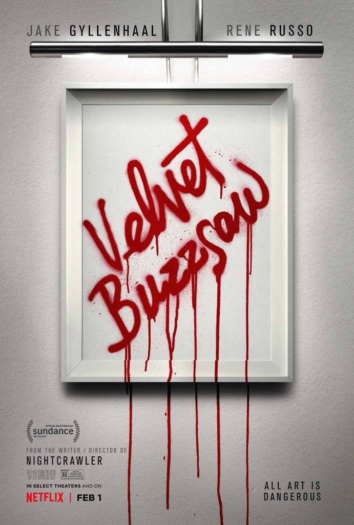 The film poster showing a white frame on a white wall with the words Velvet Buzzsaw spraypainted across it, the red paint dripping down and over the frame.