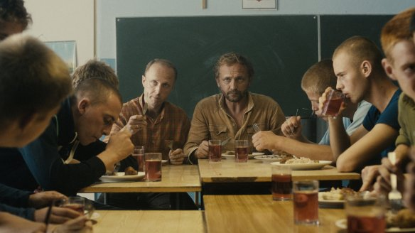 Adam (Andrzej Chyra) and Michal (Lukasz Simlat) having lunch with the boys they supervise.