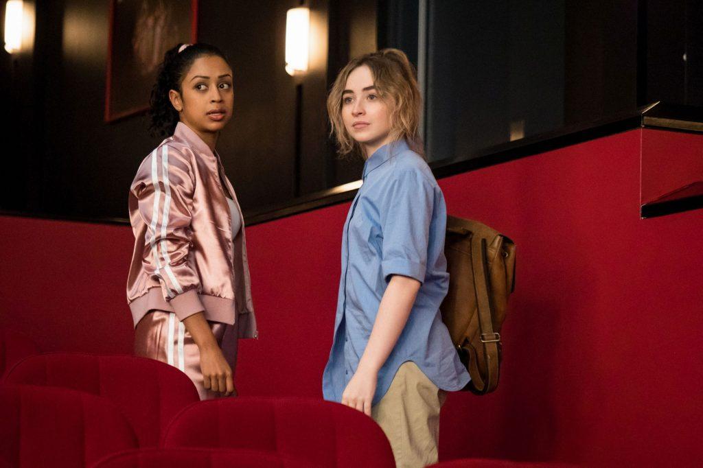 Quinn (Sabrina Carpenter) and her best friend Jasmine (Liza Koshy) leaving the auditorium together.