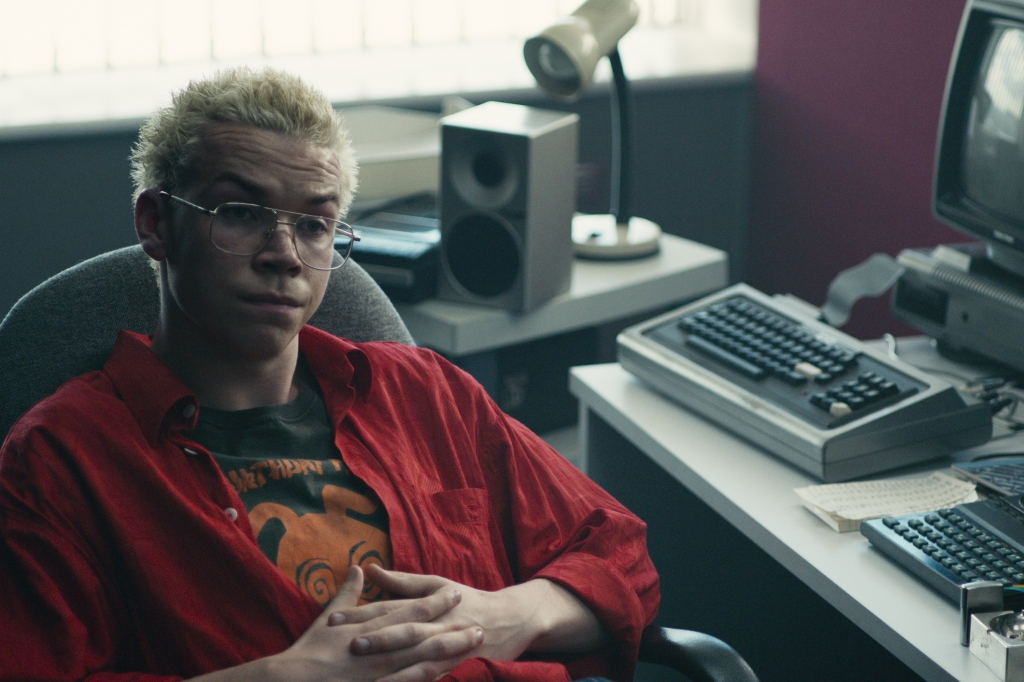 Colin (Will Poulter) at his workstation.