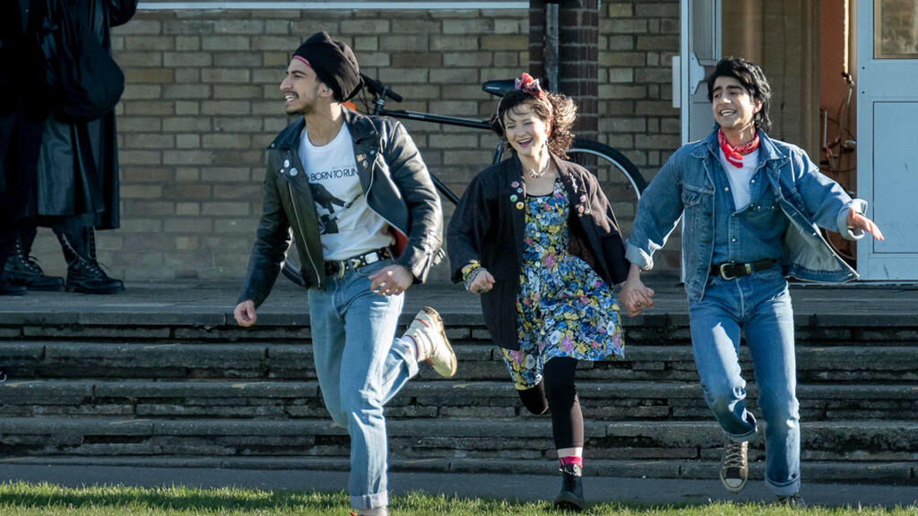 Roops (Aaron Phagura), Eliza (Nell Williams) and Javed (Viveik Kalra) running from their school building.