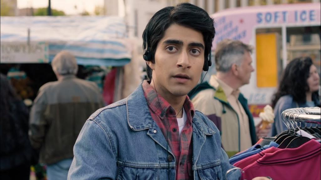 Javed (Viveik Kalra) at a fleamarket wearing his headphones.