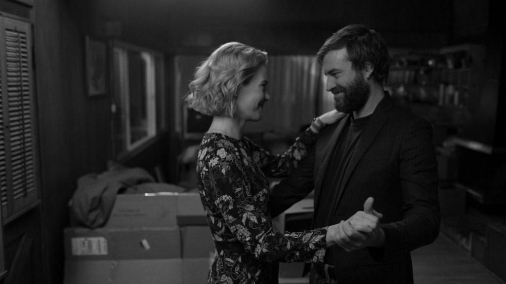 Amanda (Sarah Paulson) and Jim (Mark Duplass) dancing.