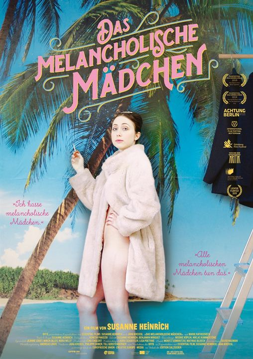 The film poster showing The Melancholic Girl (Marie Rathscheck) wearing nothing but a faux fur coat smoking a cigarette in front of a wallpaper showing a white beach and palm tree.