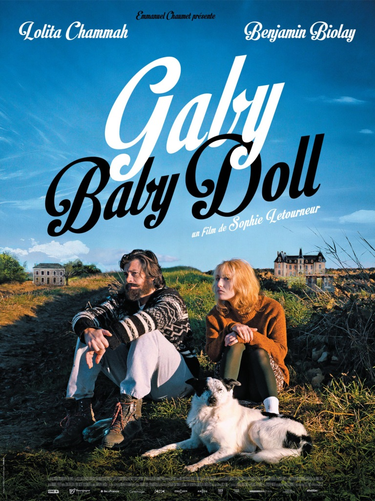 The film poster showing Nico (Benjamin Biolay), Gaby (Lolita Chammah) and Nico's Dog sitting in the grass in the sun.