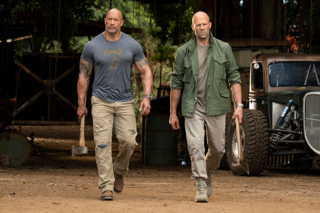 Hobbs (Dwayne Johnson) and Shaw (Jason Statham) walking fiercely, tools in hand.
