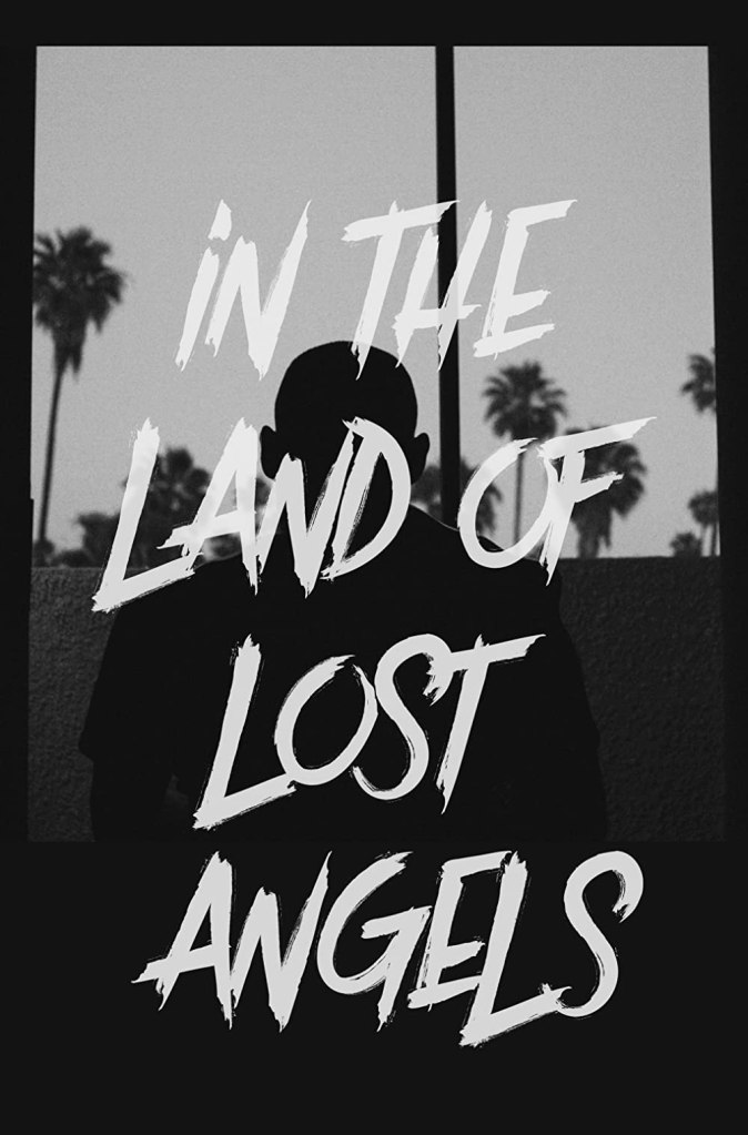 The film poster showing a black and white shot of a man looking at some palm trees.