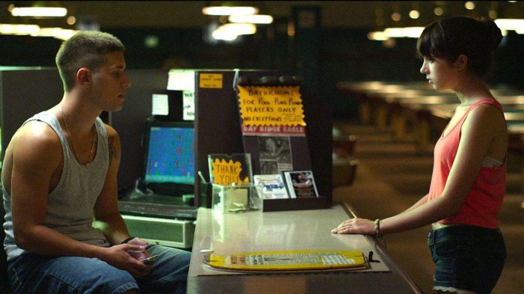 Lila (Gina Piersanti) talking to Sammy (Ronen Rubinstein) at his work.