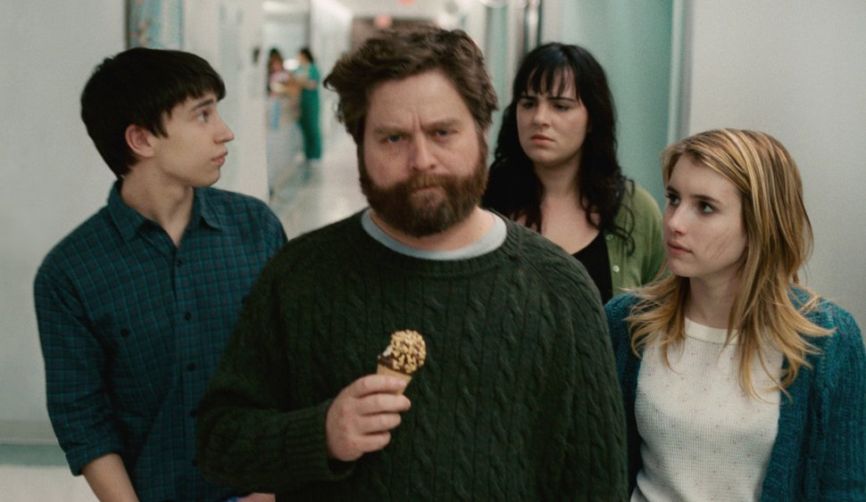 Bobby (Zach Galifianakis) eating an ice-cream, followed by Craig (Keir Gilchrist), Noelle (Emma Roberts) and another patient.
