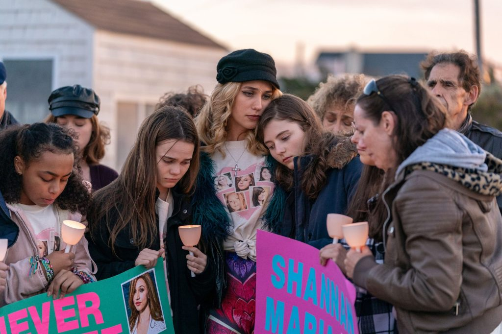 Sarra (Oona Laurence), Kim (Lola Kirke) and Sherre (Thomasin McKenzie) at a vigil for their sisters.