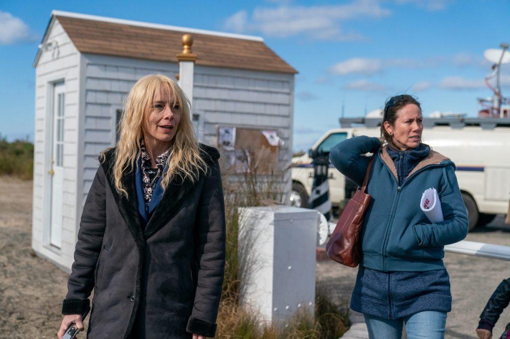 Mari (Amy Ryan) and Lorraine (Miriam Shor) walking through the neighborhood where their daughtes disappeared.