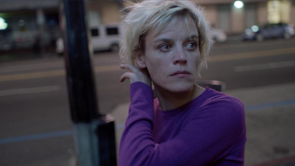 Lexi (Gemma Brockis) walking the streets of LA.