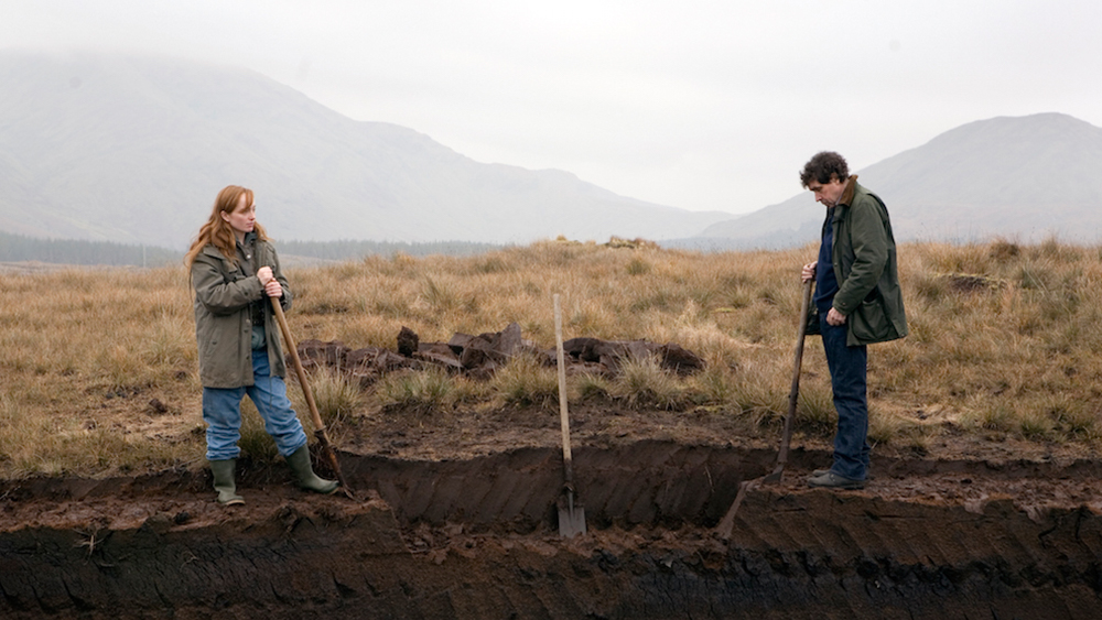 Anne (Lotte Verbeek) and Martin (Stephen Rea) working together in the moors.