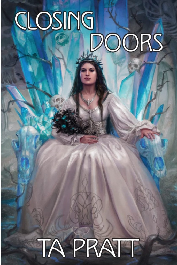 The book cover showing a woman with long black hair in a bridal gown sitting on a thorne of ice, thorns and skulls.