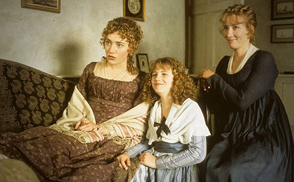 The Dashwood sisters - Marianne (Kate Winslet), Margaret (Emilie François) and Elinor (Emma Thompson) - sitting on and around a sofa.