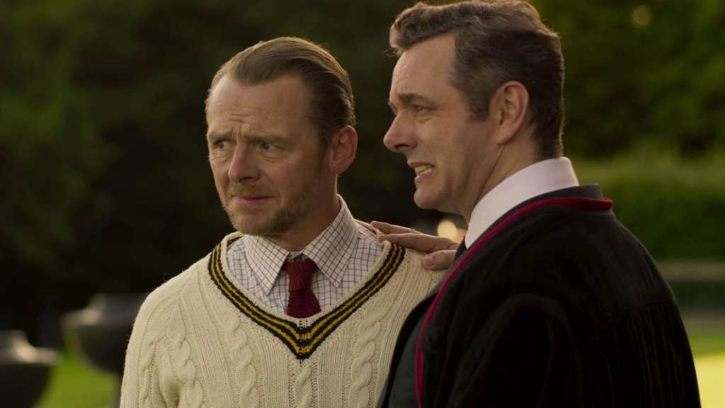 Teacher Meredith (Simon Pegg) and principal The Bat (Michael Sheen) looking at something with a pained expression on their faces.