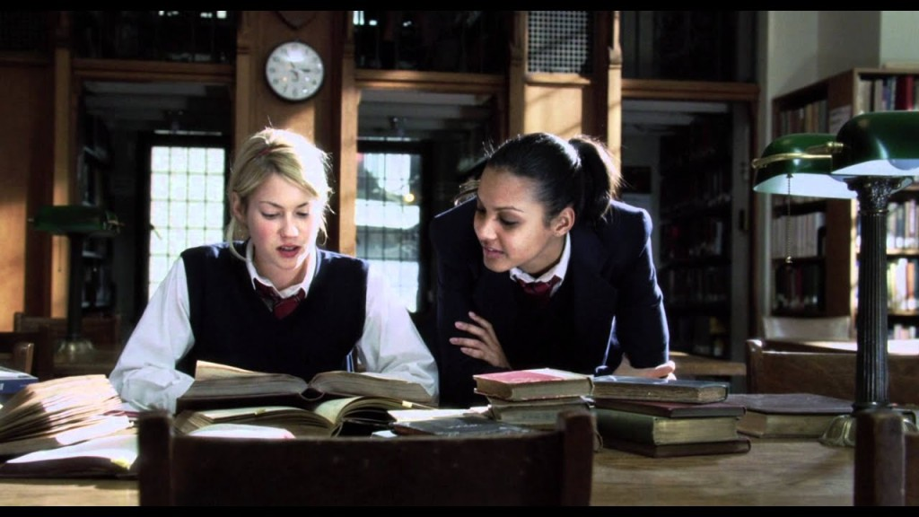 Sarah (Laura Ramsey) telling Kate (Jessica Lucas) about her research on the Sons of Ipswich.