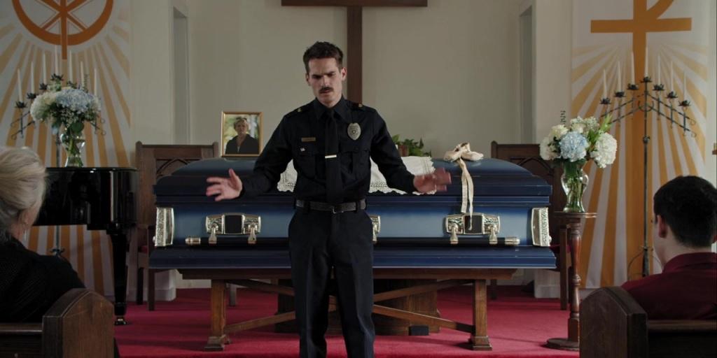 Jim Arnaud (Jim Cummings) at his mother's funeral.