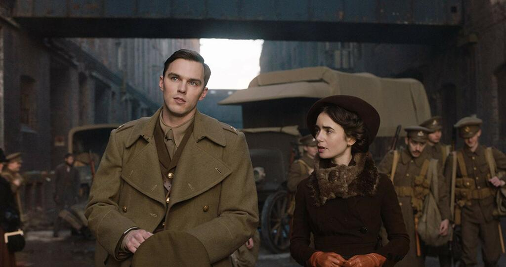 J. R. R. Tolkien (Nicholas Hoult) talking to Edith (Lily Colins)