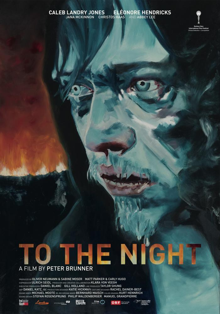 The film poster showing Norman (Caleb Landry Jones) painted in blue colors with a red fire behind him.