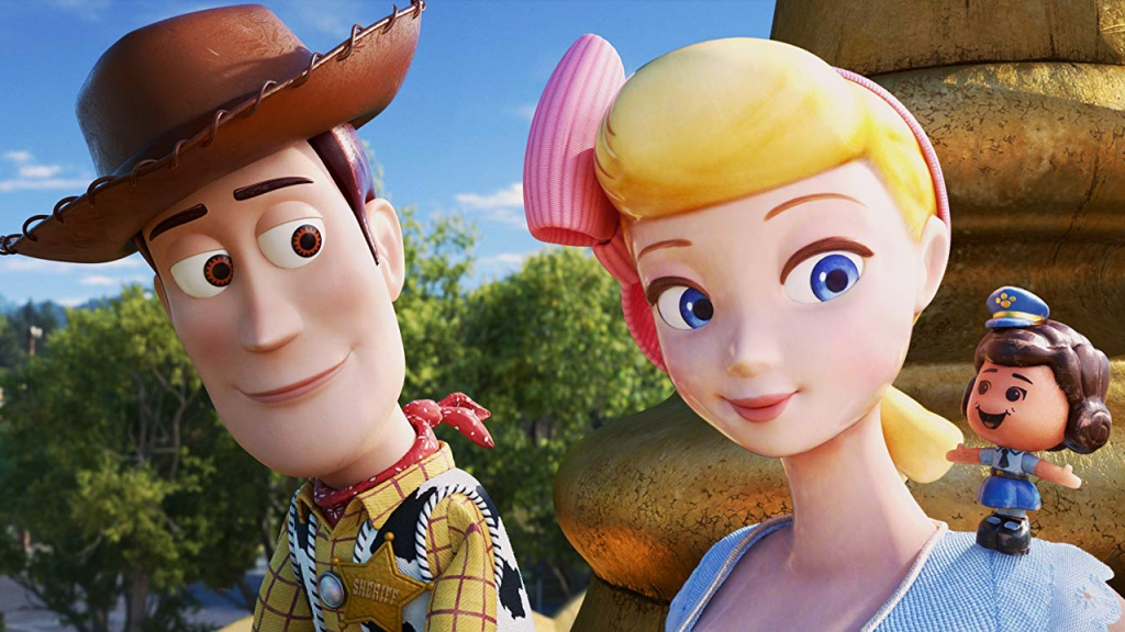 Woody and Bo Peep talking to a toy police woman.