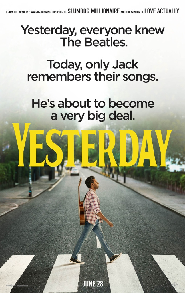 The film poster showing Jack (Himesh Patel), a guitar strapped to his back, walking across a crosswalk like the famous Abbey Road Beatles album cover.