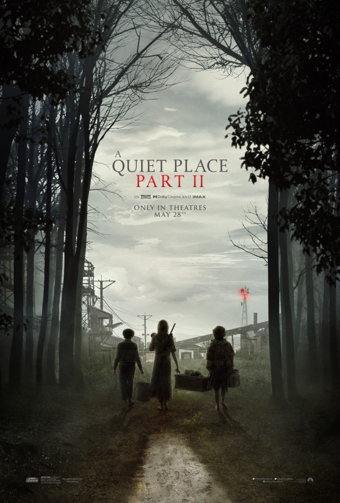 The film poster showing Evelyn (Emily Blunt), Regan (Millicent Simmonds) and Marcus (Noah Jupe) carrying a box and some bags, entering an abandoned factory area from the forest.