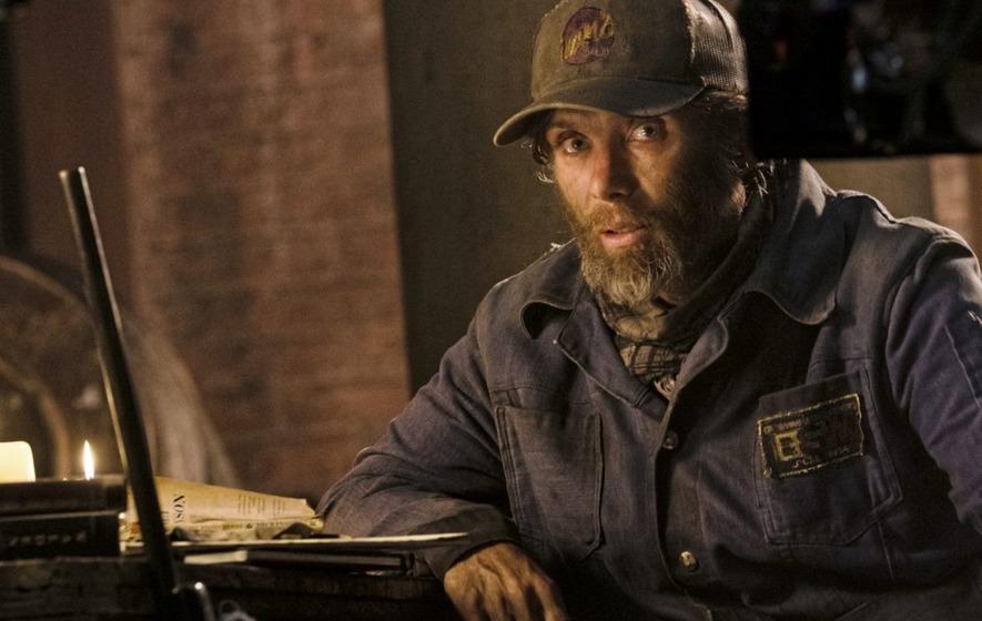 Emmett (Cillian Murphy) sitting in his makeshift home.