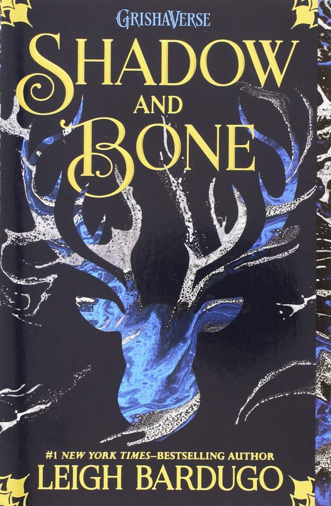 The book cover showing a stag shape that seems to be filled with water or blue color on black background.