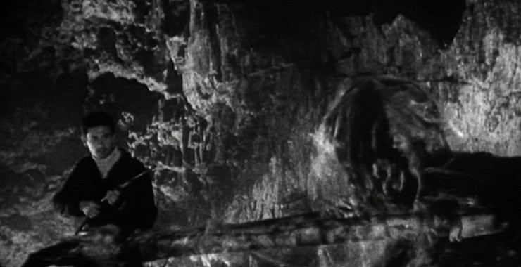 Gil (Michael Forest) stalking the monster in its cave.