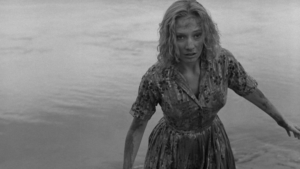 Mary Henry (Candace Hilligoss) emerging from the river.