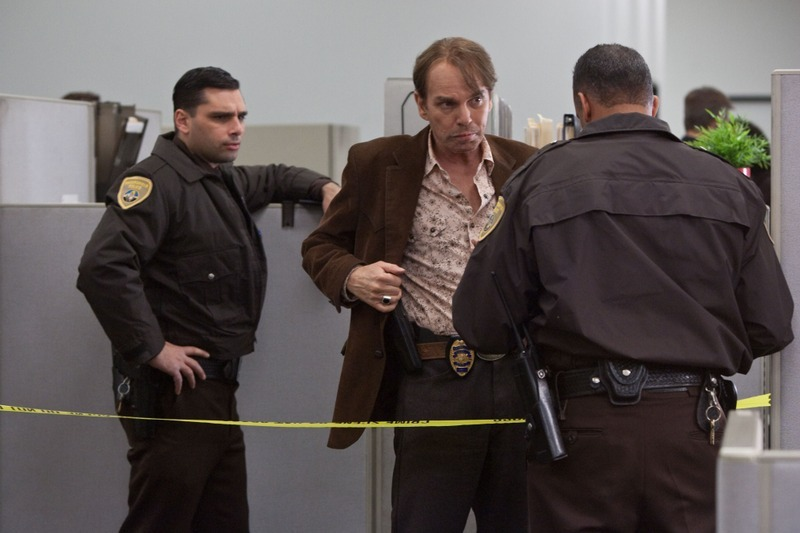 The Cop (Billy Bob Thornton) arriving at the crime scene.