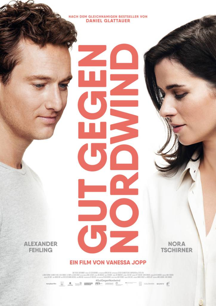 The film poster showing Leo (Alexander Fehling) and Emmi (Nora Tschirner) in white shirts, looking towards but not quite at each other, separated by the film's title.