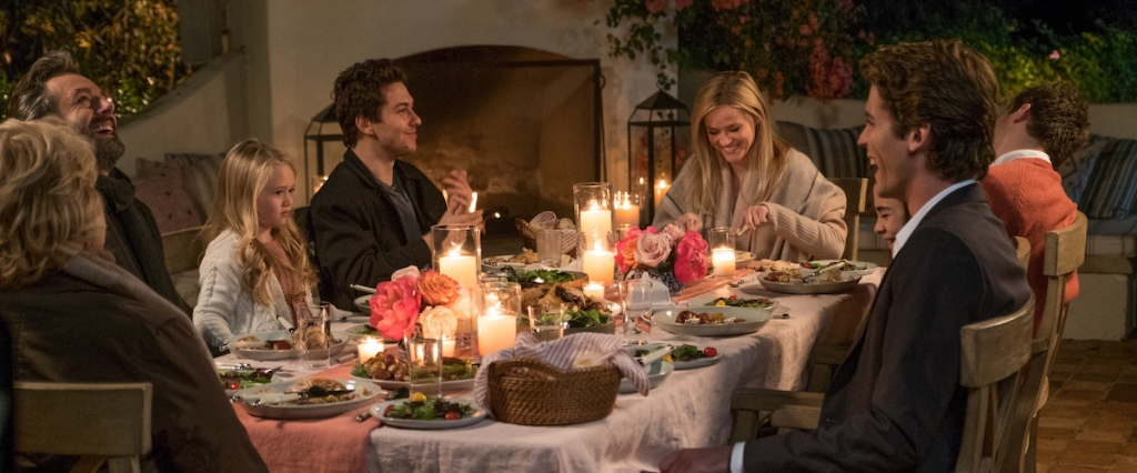 Alice (Reese Witherspoon) with her family and the boys around the dinner table.