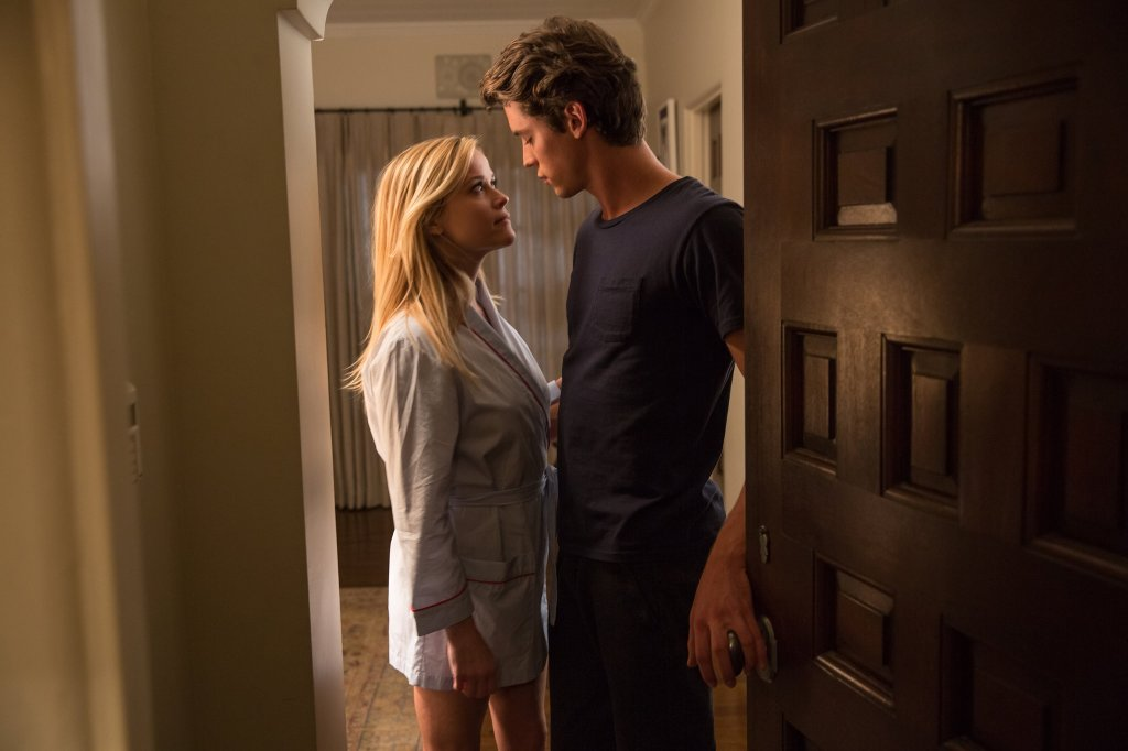 Alice (Reese Witherspoon) and Harry (Pico Alexander) about to kiss in a doorway.