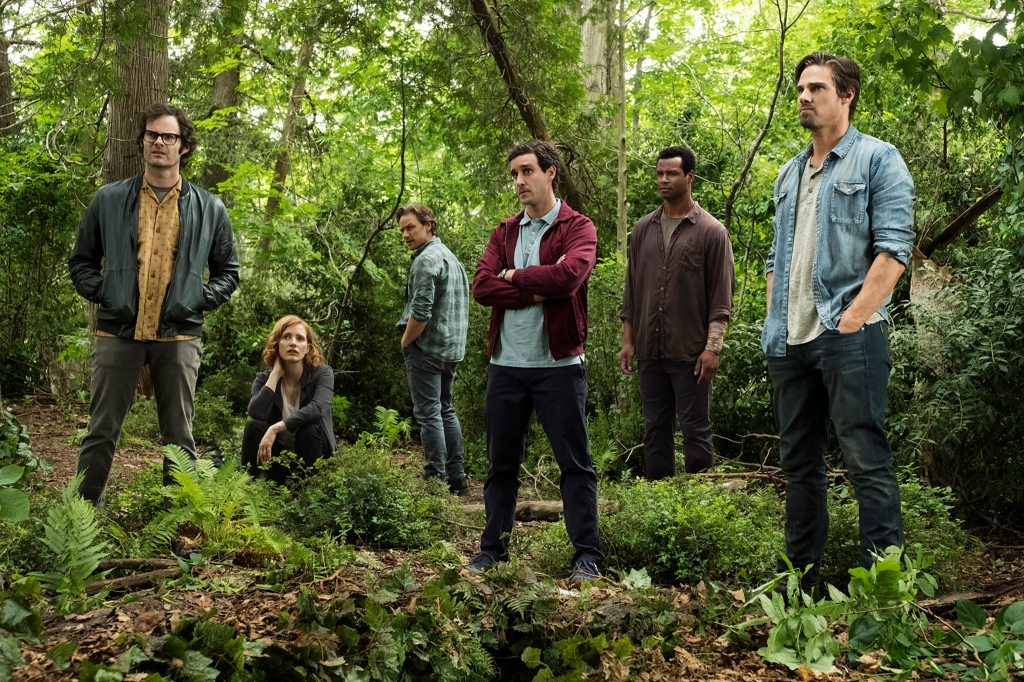 The Losers Club, now adults, in the forest.