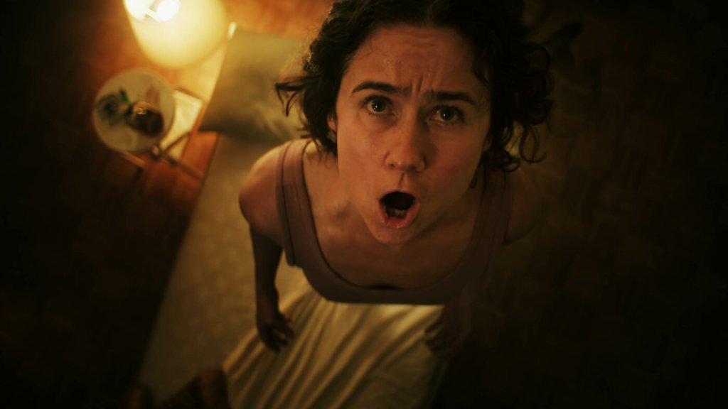 Molly (Cecilia Milocco) looking at her ceiling, her mouth open as if screaming.